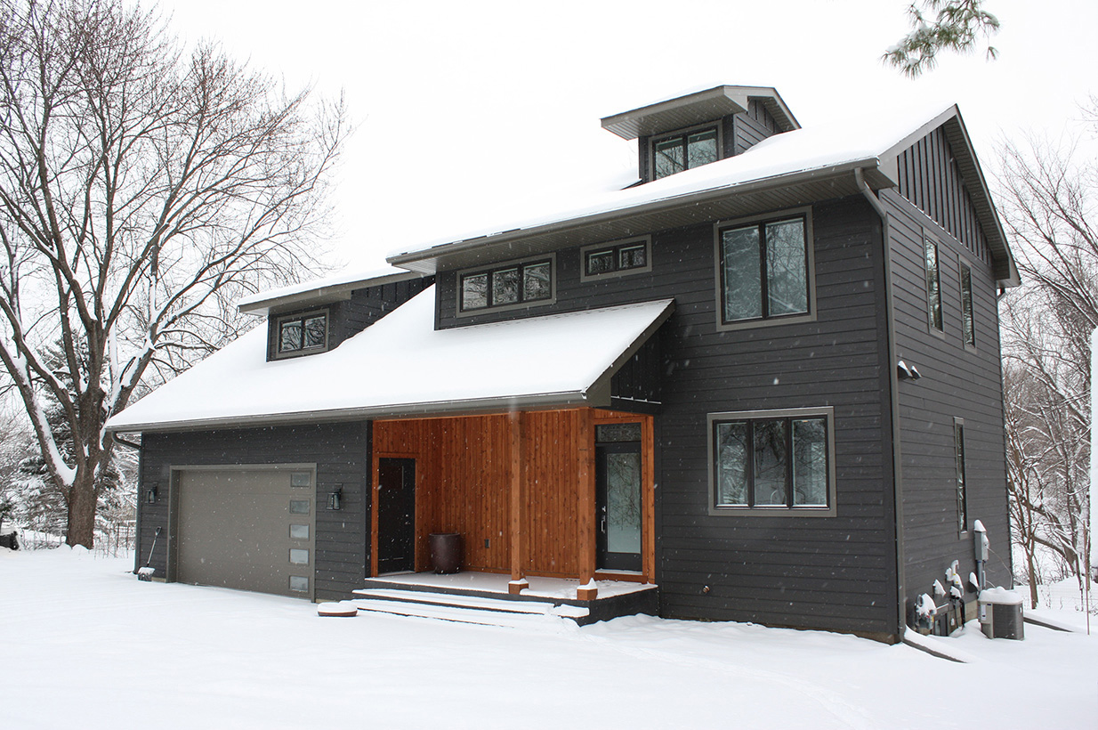 new home exterior in snow